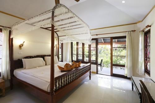 Superiorタイプの部屋。天蓋付きのベッドが印象的